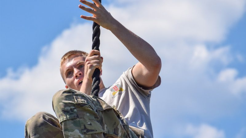 A cadet completes the rope climb of the Corps of Cadets' obstacle course during the annual JMAC athletic competition on April 11.