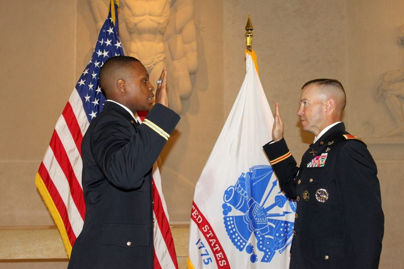 Col. Kevin Milton, at right, administers the oath of office to Joseph Cowen.
