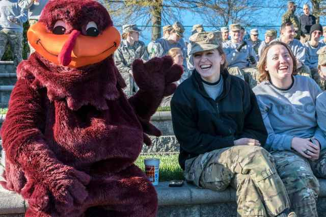 Former interns Katelyn Margraf '16, at center, and Katie Mazzola '17 with the HokieBird.