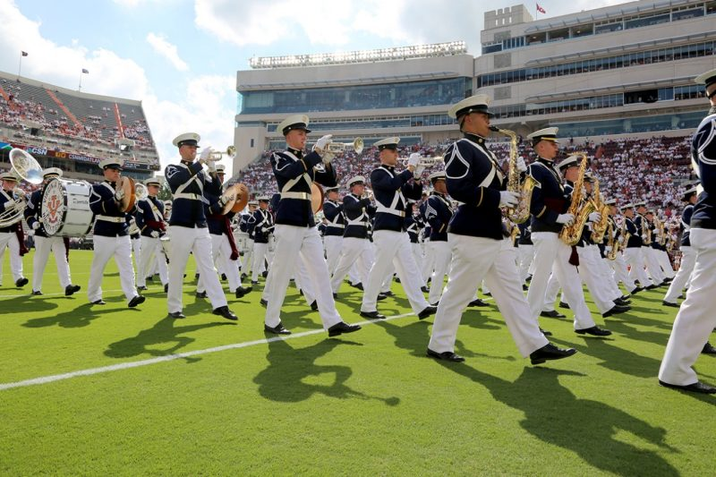 The Highty-Tighties perform during a football game in Lane Stadium.