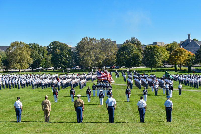 Cadet stand in formation during a military parade on Virginia Tech's Drillfield.