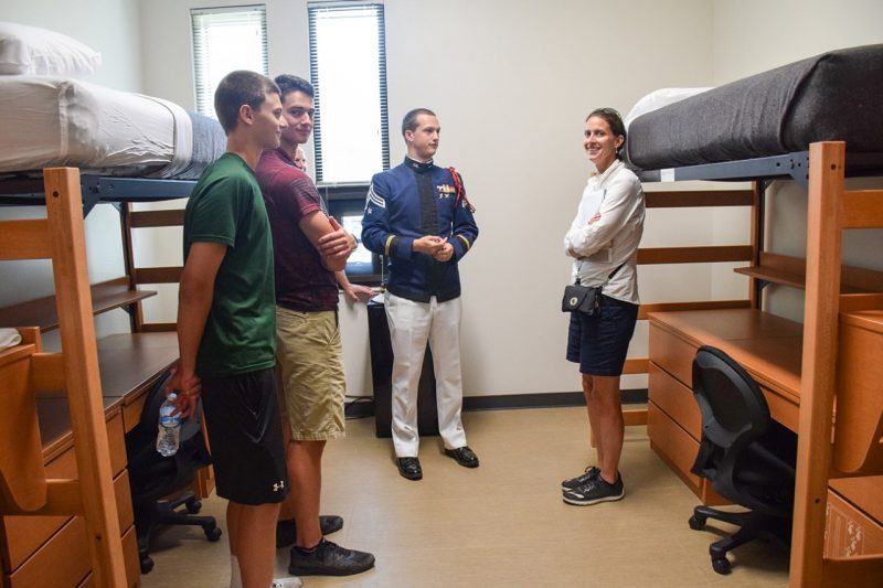 People look at a cadet room in New Cadet Hall.